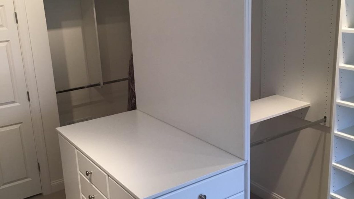 Master Closet in White with Custom penninsula